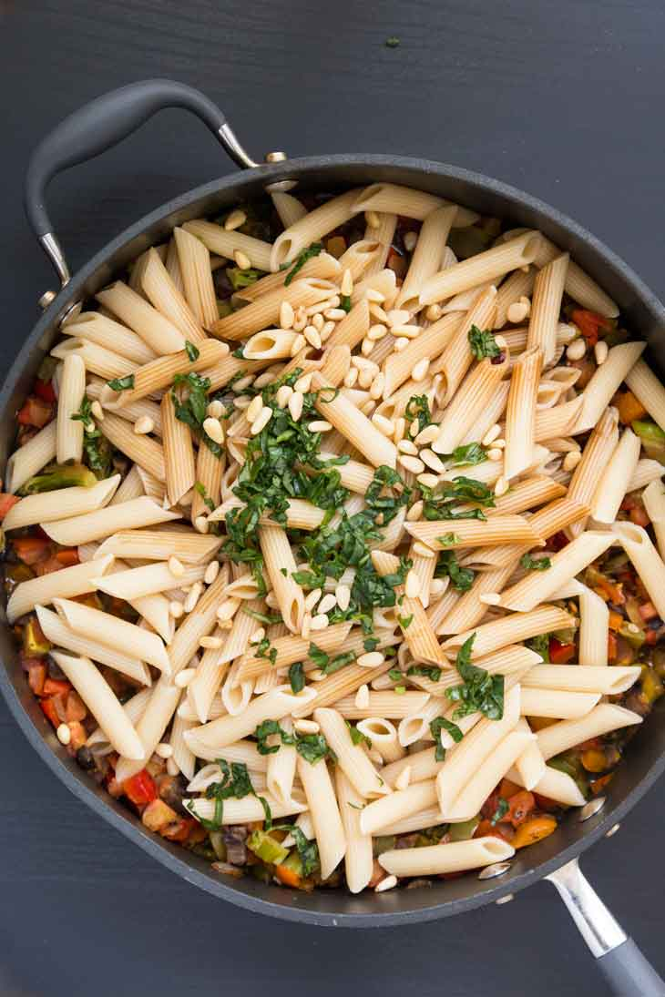 Overhead photograph of pasta with veggies. This is a step by step on how to make pasta.