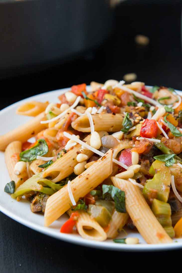 Side photograph showing a closeup italian dish of pasta with veggies.