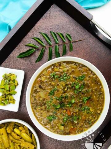 Overhead photograph of curried black lentil soup