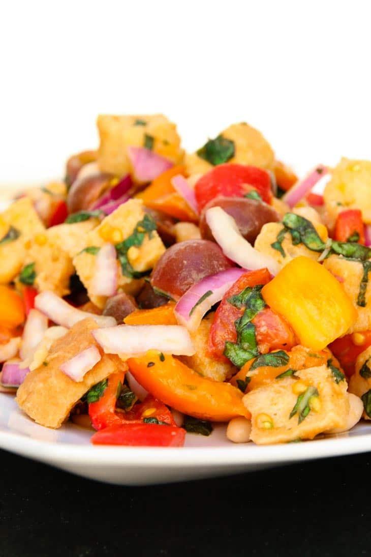 A close up of tuscan panzanella salad on a plate