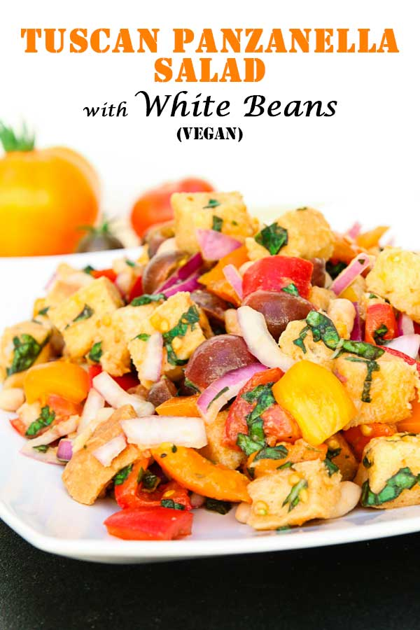 Take things up a notch and turn a traditional Tuscan Panzanella Salad into a complete meal by adding white beans! It's easy, 15 minutes to prep, and delicious! #vegansalad #breadsalad #tomatoes #easyveganrecipe