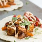 Crispy Tofu Tikka Masala Tacos with Peppers, Onions, & Chilifire Crema