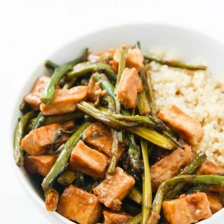 Teriyaki Tofu stir fry over cooked quinoa