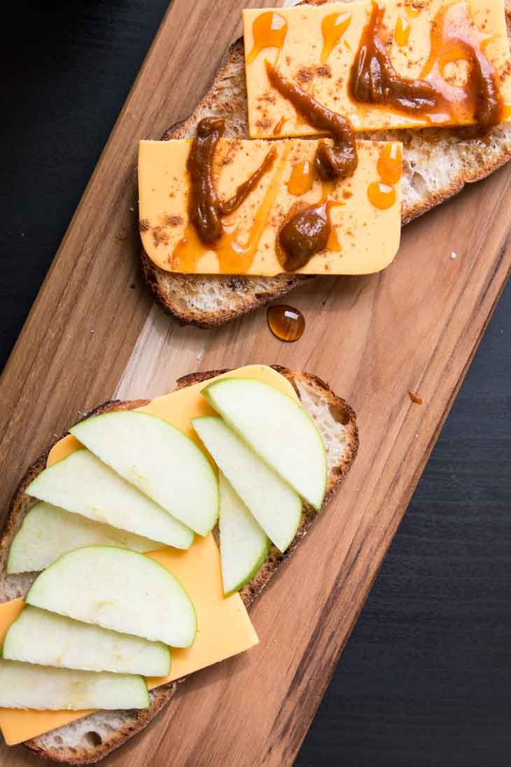 An overhead photograph of a open-faced vegan grilled cheese with apples and pumpkin butter.