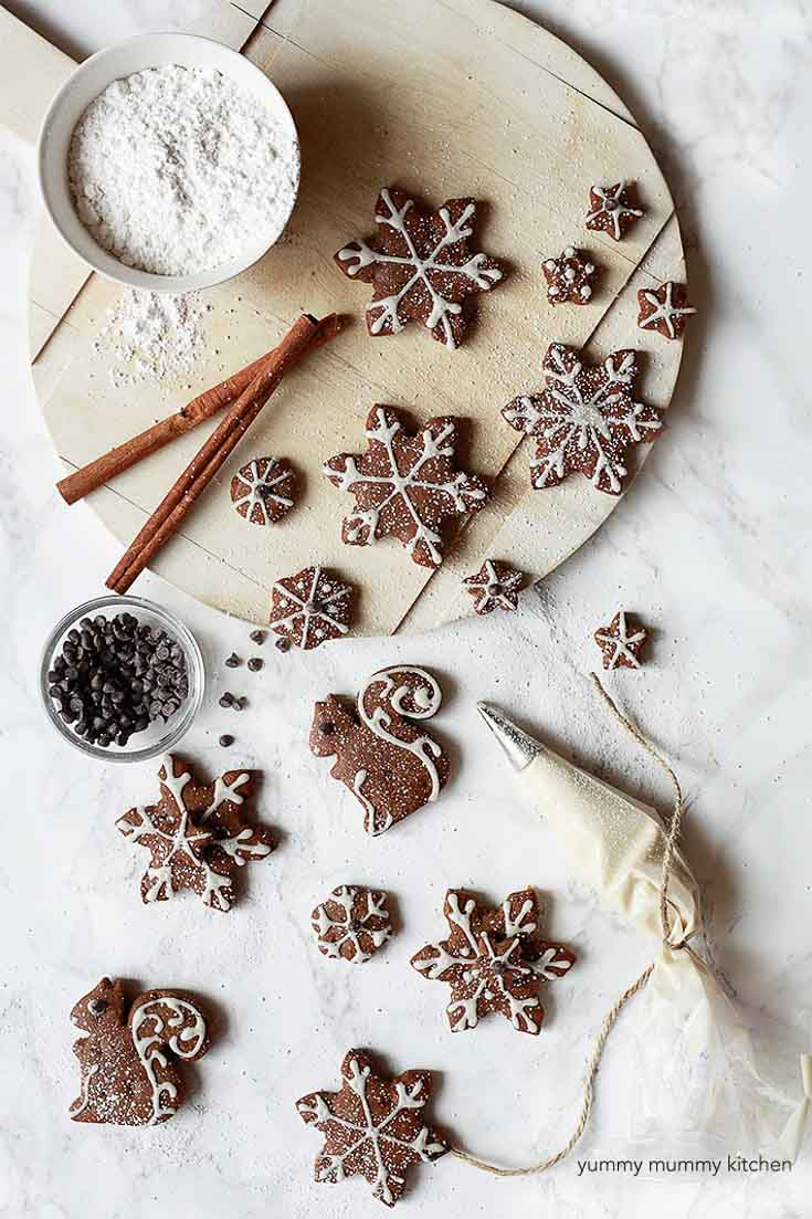 Gingerbread cookies cut out into shapes, and decorated with chocolate and frosting.