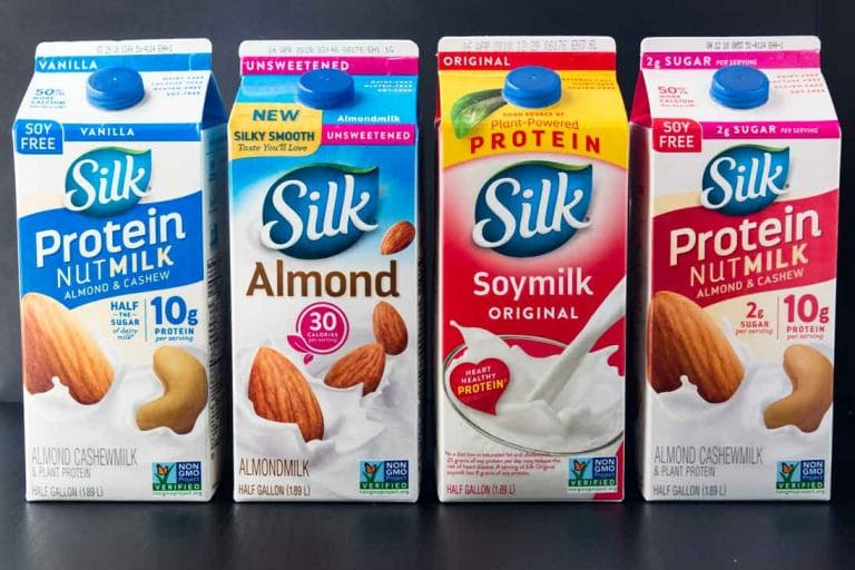 A photograph of four different silk plant-based milks.