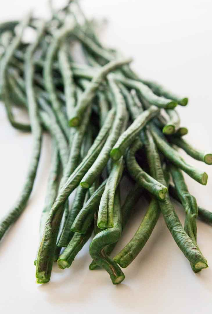 A close up photograph of yard long beans, or green beans.