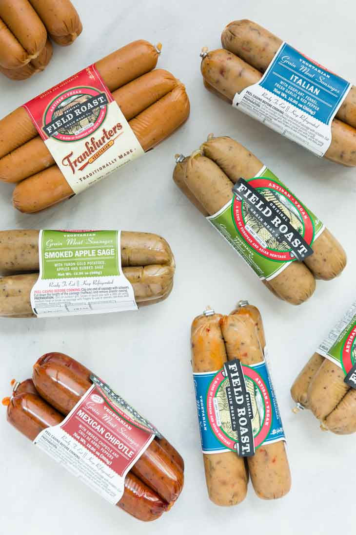 An assortment of field roast vegan sausage flavors for use in variety of dishes, including a vegan pasta salad.