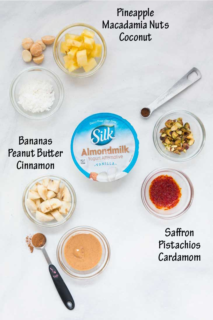 Overhead photograph showing ingredients going into 3 healthy yogurt cup combinations.