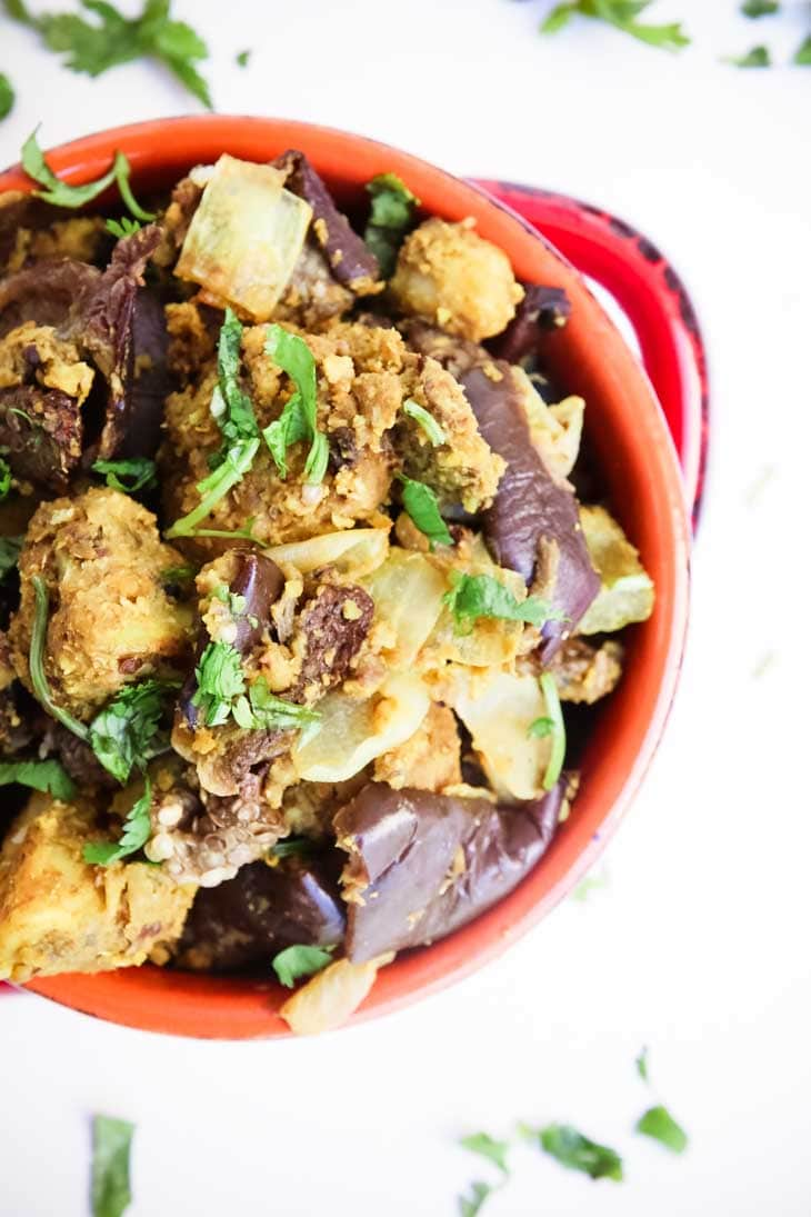 An overhead shot of Indian spiced baked eggplant and potatoes in a bowl