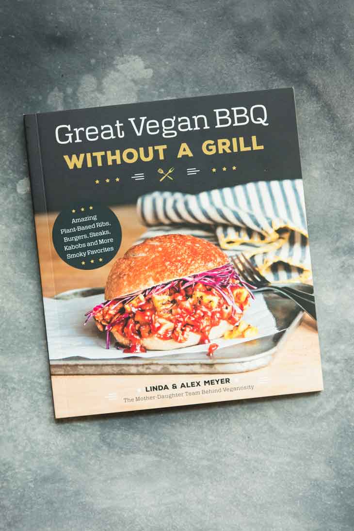 Overhead shot of great vegan bbq cookbook, containing bbq sandwich recipes.