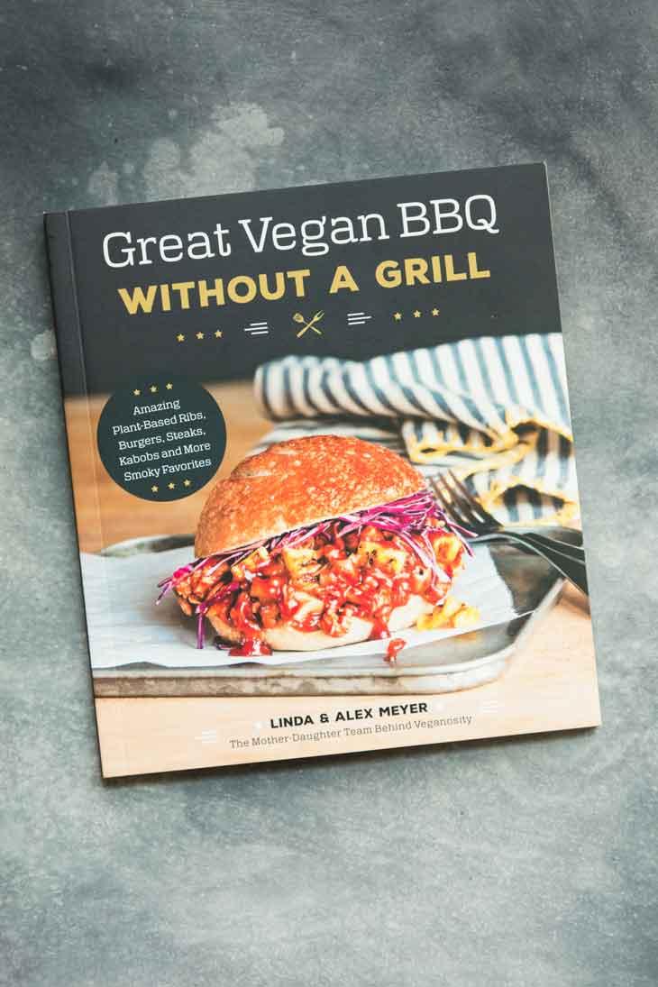 Overhead shot of great vegan bbq cookbook, containing bbq sandwich recipes.