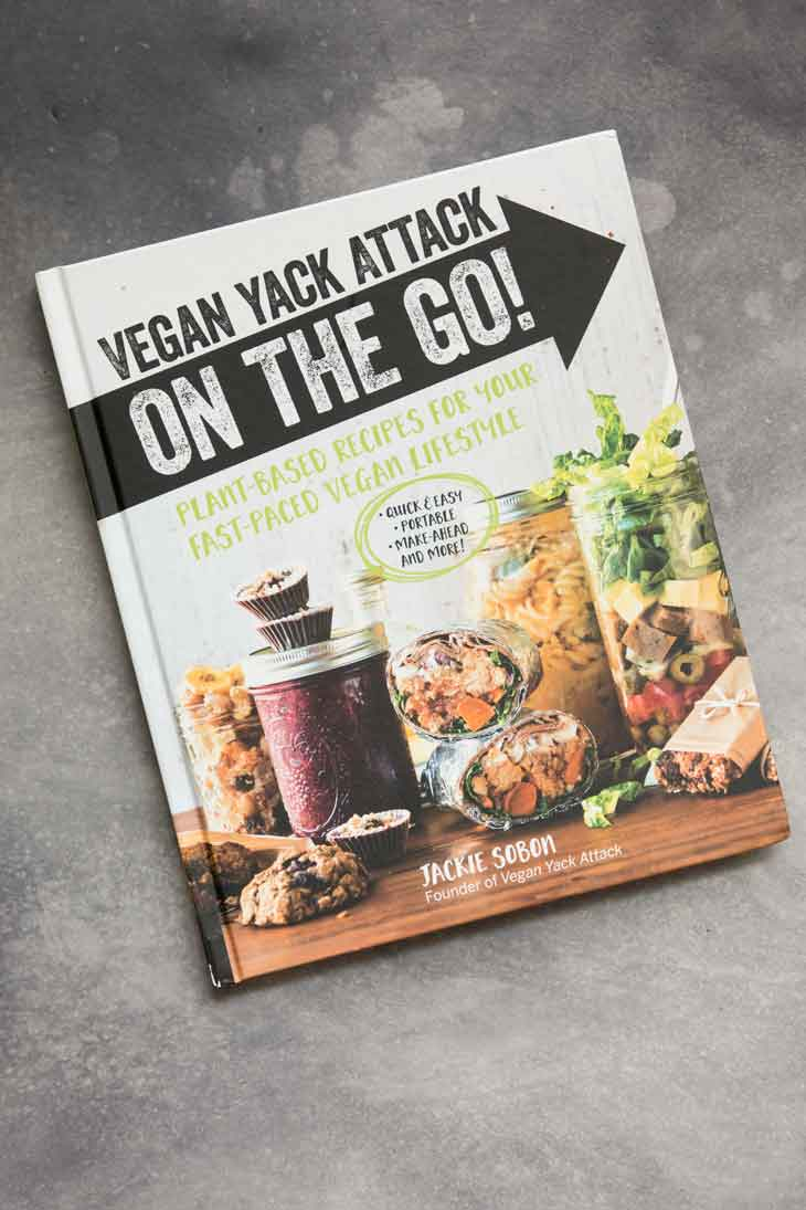 Overhead photograph of a vegan yack attack on the go cookbook containing vegan blt sandwich recipe.