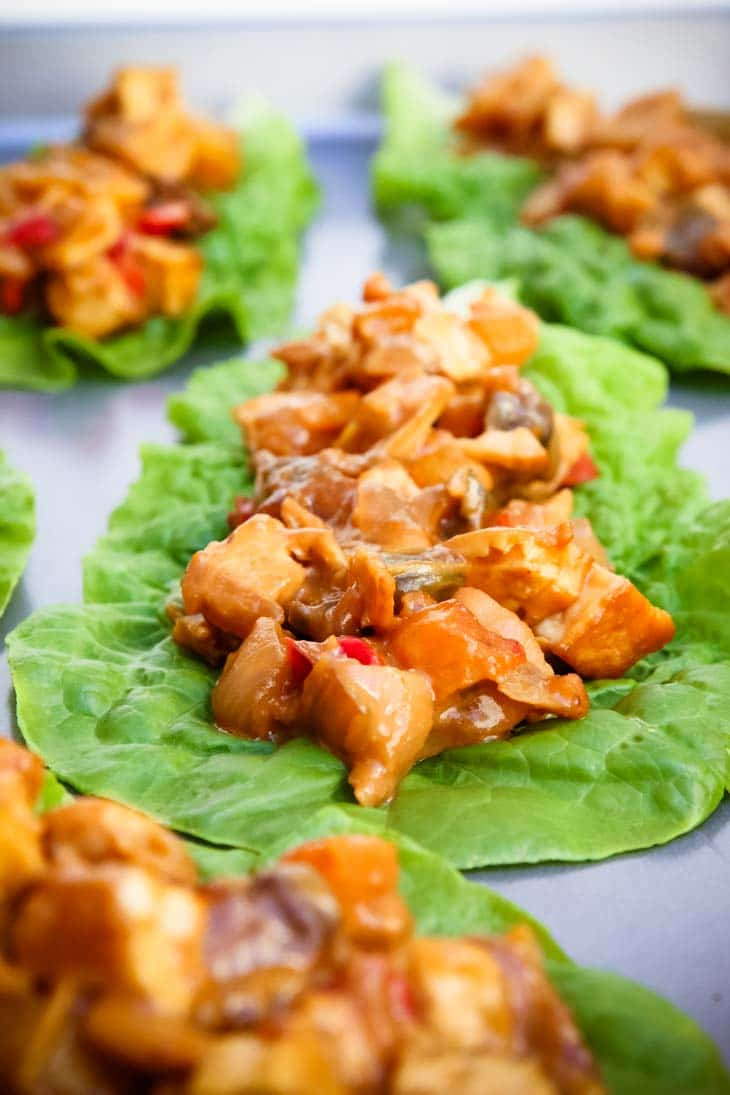 A close up of tofu peanut lettuce cups