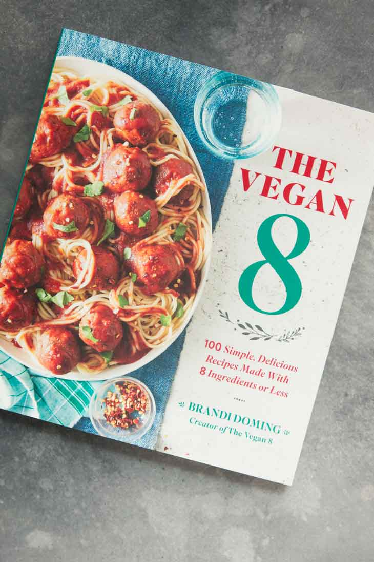A photograph of the new Vegan 8 cookbook with vegan pumpkin muffin recipe.